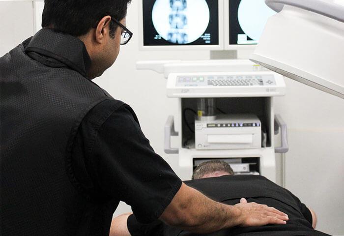 Dr. Khan examining a patient